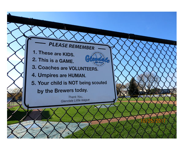 Warning sign outside baseball field